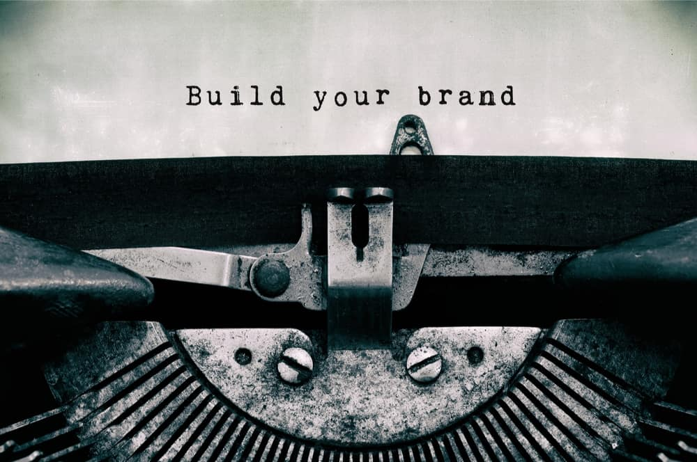 build your brand written on paper with typewriter